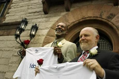 Keith Maynard (left) and Chip McLaughlin exited Cambridge City Hall smiling and with their vows displayed on t-shirts.