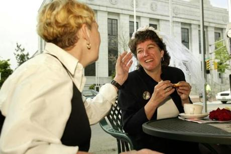 GAY MARRIAGE REMOTE TRANSMISSION -- REMOTE TRANSMISSION--- 5/17/2004 -- Cambridge, MA -- Outside the 1369 Coffeehouse next to Cambridge City Hall -- Jean McGuire beams at her soon-to-be bride, Barbara Herbert, as the enjoy a coffee at their favorite coffeehouse before their wedding at 11:30 am. The wedding veil is a present from the 1369 Coffeehouse, where each of the couple's three children held their first jobs. Jean and Barbara were married by Cambridge City Counselor at 11:30 am. Jean McGuire is a visiting professor at Northeastern University; Barbara Herbert is an emergency room physician.outtake