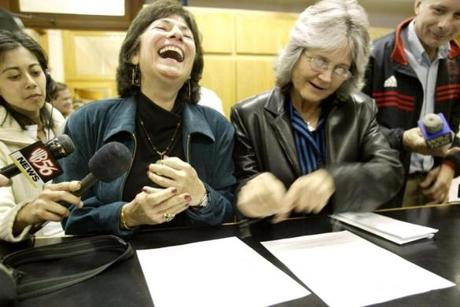 GAY MARRIAGE REMOTE TRANSMISSION -- REMOTE TRANSMISSION--- 5/17/2004 -- Cambridge, MA -- Cambridge City Hall -- Marcia Kadish (left) and Tanya McCloskey are giddy as they give their paperwork one last review before rushing upstairs to be the first couple to be married in Cambridge on Monday morning.outtake