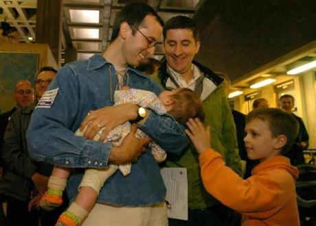 GAY MARRIAGE REMOTE TRANSMISSION -- REMOTE TRANSMISSION--- Boston, Ma-- May 17, 2004 While waiting to apply for their marriage license at Boston City Hall on Monday Christian Schlesinger (cq and left) and Russ Irwin (cq in the back) and holding their daughter eight-month old Nina Porter (Cq) as friend of the family Buster Coen (Cq), 8, of New York City caresses the baby. photo by Essdras M Suarez/Globe staff outtake