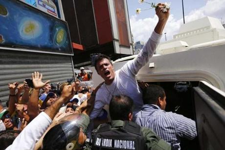 Venezuelan opposition leader Leopoldo Lopez surrendered to security forces on Feb. 18 after charges were lodged against him following a protest rally.