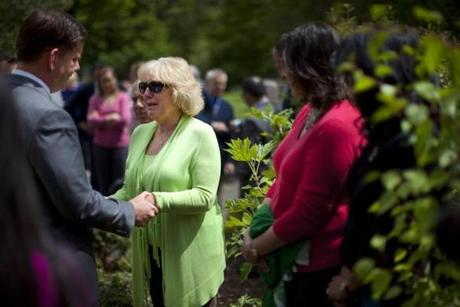 5/19/2014 - Boston, MA - Mayor Martin J. Walsh, cq, left, spoke with Diane Hunt, cq, of Kingston, MA, who lost her son in the 9/11 terrorist attacks. At right is the Boston 9/11 Survivor Tree, which Mayor Walsh had just dedicated and unveiled a plaque at the Massachusetts 9/11 Garden of Remembrance in the Public Garden on Monday, May 19. The woman in red is Karin Charles, cq, of Framingham, MA, who lost her husband in the attack. The Survivor Tree is a Callery pear tree, grown from cuttings taken from the single surviving tree that remained at the World Trade Center site after the attacks on 9/11. BostonÕs tree is planted at the Public Garden adjacent to the Garden of Remembrance dedicated to Massachusetts victims of the 9/11 attacks. Standalone. Dina Rudick/Globe Staff.