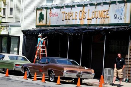 Period cars in front of a mock-up of Triple O's Lounge used in the filming in Cambridge on May 21.