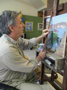 "David Montgomery, who makes marine art and portraits, is a former boat builder who tries ""to capture the essence of Gloucester Harbor."""