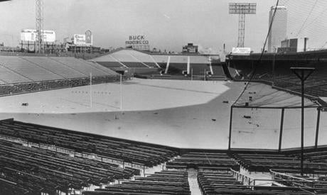 Fenway Park hasn't hosted football since the 1960s, when the Patriots regularly played home games there. This shot of snow blanketing the football-ready Fenway grass was taken in December 1964.