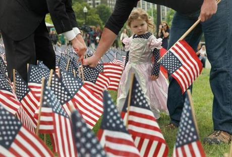 Boston, MA 052214 Sloan Ouellette (cq), 3, looked on as her uncle, Ken Ouellette (cq) of Watertown planted a flag in memory of his brother, Brian Ouellete (cq), on Boston Common, Thursday, May 22 2014. Ouellette (cq) was a navy seal who died in 2004 in Afghanistan. (Wendy Maeda/Globe Staff) section: Metro slug: 23memorial reporter: Laura Crimaldi