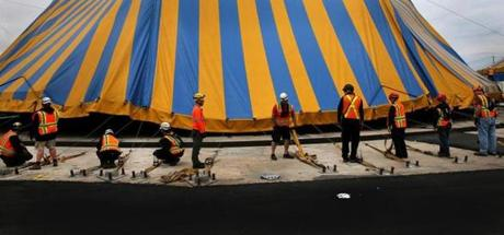 BOSTON, MA - 5/22/2014:TENTS UP the raising of Cirque du Soleil's iconic blue and yellow Big Top and the set up of the Cirque du Soleil Village at Marine Industrial Park – 6 Tide Street, Boston. The Big Top seats more than 2,600 people, 19 meters high and is 51 meters in diameter, 4 masts each stand at 25 meters tall and requires 550 'tent pegs' (1.5 meters each) to secure it firmly to the ground. Cirque du Soleil's Amaluna is playing from Thursday May 29 until July 6 2014. (David L Ryan/Globe Staff Photo) SECTION: METRO TOPIC stand alone photo