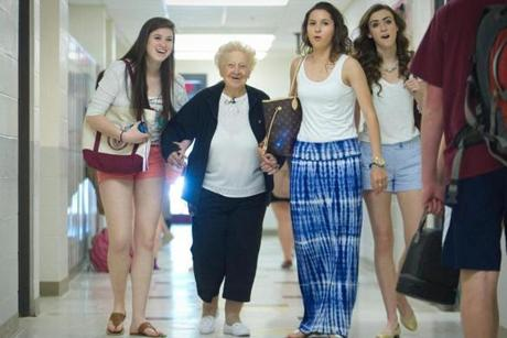 "Genevieve Johnson, 94, was escorted to class by a ""dream team"" of classmates at Westford Academy. She has been taking English, history, and acting classes after dropping out in the 1930s."