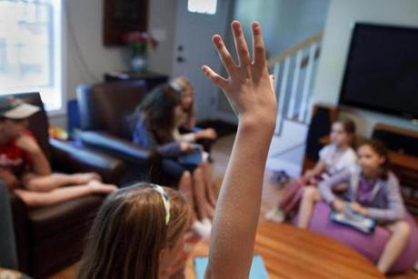 "6/01/2014 - Arlington, MA - A group of fourth-grade girls met at Anjali Duva's home, cq, to discuss the book of the month ""Esperanza Rising."" Topic: Not Your Mother's Book Club(2). Story by Beth Teitell/Globe Staff. Dina Rudick/Globe Staff."