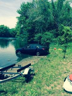 The owner's car was pulled from the pond.