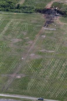 Skid marks could be seen in the grass running off the runway.