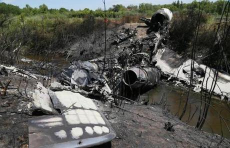 The two engines of the plane looked fairly intact, but broken and lying at the bottom of the ditch.