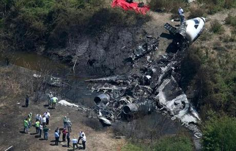 The plane was visible Monday at the bottom of a gully at the end of a runway.