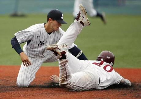 St. John's Prep's Rosario Missiti tagged out Lowell's Keith Lynch trying to steal second during their May 28 game.