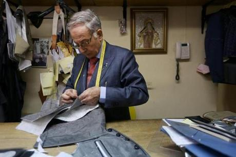 "Antonio Lopez Fuentes works on the vest of a ""traje de luxes,"" or suit of lights. Fuentes is head tailor and owner of Fermín, a shop that specializes in the outfits worn by Spain's bullfighters."