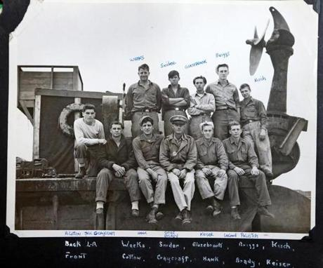 A photo provided by Arthur Cotton, who landed on Utah Beach on D-day, shows him at far left with his crewmates sometime after their landing.