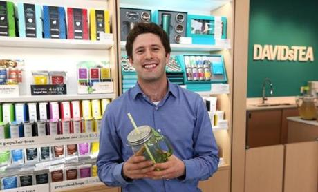 "DavidsTea cofounder David Segal holds the store's mason jar for iced tea, and flavors include ""movie night"" tea."