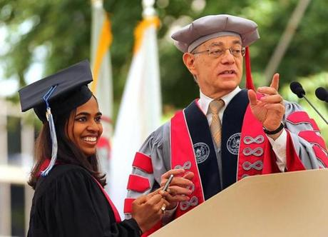 Class President Anika Gupta (left) stood with MIT President L. Rafael Reif after her speech.