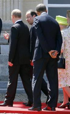 Russian President Vladimir Putin (left) talked to French President Francois Hollande as they walked next to President Obama and Britain's Queen Elizabeth (right) after posing for a group photo.