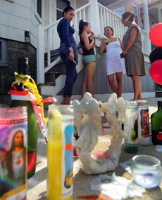 Residents gathered at a memorial on Taft Street in Dorchester where Michael DePina was killed Friday.