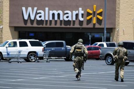 The suspects then fatally shot a third person before killing themselves at a Walmart, police said.