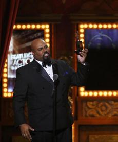 "James Monroe Iglehart accepted the Tony for Best Featured Actor in a Musical for ""Aladdin."""