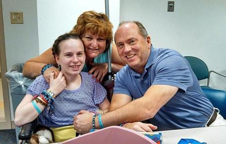 Linda and Lou Pelletier with daughter Justina last year.