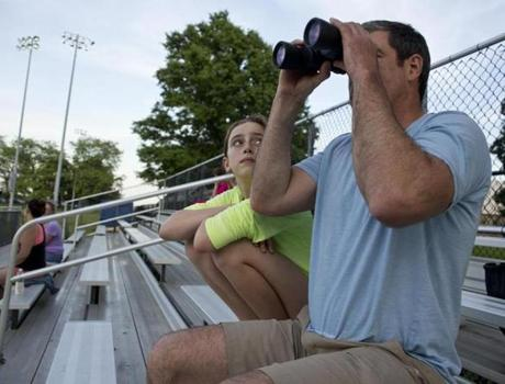 Patrick Fitzgerald, with his daughter, Juliet, 11, watched his son play Little League for the Boston Home Inspectors White Sox earlier this month. Fitzgerald said the guaranteed one-hour game time of youth hockey is nice.