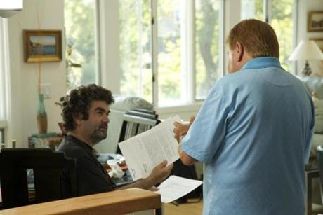 Academy Award nominated director Joe Berlinger (left) reviewing documents with former FBI agent Robert J. Fitzpatrick (right) on the set of WHITEY: United States v. James J. Bulger. Directed by Joe Berlinger. For RadicalMedia and CNN Films. Photo credit: Daniel Wilson. 20whiteyfilm 15ptownside
