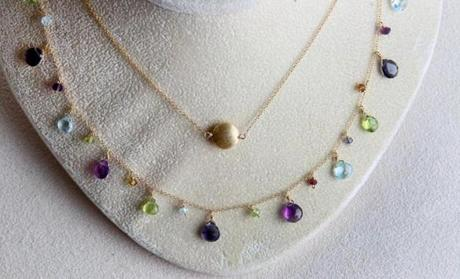 SOUTH END, MA -- June 10th, 2014 - Busy and color with simple. Jewlery from Laura Preshong, a Boston based jewlery designer, - how to layer necklaces (globe staff photo :Joanne Rathe section: g topic: layer necklaces reporter: Kelly Gifford)