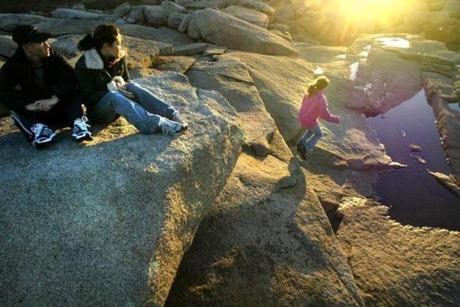 Kiara Silva (right) of Reading played on the rocks at Halibut Point State Park in Rockport.