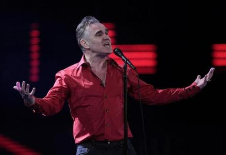 "EDS NOTE THIS IMAGE IS EMBARGOED UNTIL 20:00 GMT TUESDAY FEB. 11, 2014 AND CANNOT BE USED BEFORE THAT TIME - FILE - In this Friday Feb. 24, 2012 file photo, British singer Morrissey performs at the 53rd annual Vina del Mar International Song Festival in Vina del Mar, Chile. A savage review of Morrissey's best-selling memoir won Britain's Hatchet Job award Tuesday Feb. 11, 2014 for the year's most cutting book review. ""Autobiography"" topped the British best-seller lists when it was published last year. It appeared under the Penguin Classics imprint, a rare designation for a living writer. (AP Photo/Jorge Saenz, File) 15thingtank"