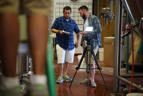 Plymouth Ma 06/11/2014 Jeremy Quaglia (cq) left and Shane Uriot (cq) right filming at the Mayflower Brewing Company in Plymouth.Boston Globe Staff/Photographer Jonathan Wiggs Topic: Reporter: