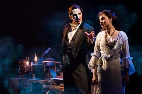 "Broadway In Boston presents ""THE PHANTOM OF THE OPERA."" Pictured: ""The Music of the Night"" - (From L): Cooper Grodin as The Phantom and Julia Udine as Christine Daae. Photo credit: Matthew Murphy -- 18summertheaterpicks -- 22Mackintosh"
