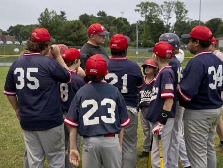 John Walker, manager of Sullivan Insurance baseball team, gave his players a pregame talk.