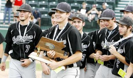 Kevin Martinis (with trophy) led Bellingham to its first baseball championship. Bellingham defeated Monument Mountain in the Division 3 title game.