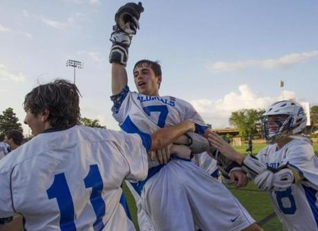 6/14/14 Boston, MA Teammates hoist up Christopher Wiggins after he scored the winning goal AB beat Duxbury 5-4 in double overtime