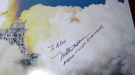 Alex Craig, who periodically spoke with Silveira by phone, recieved a signed poster from the former NASA engineer.