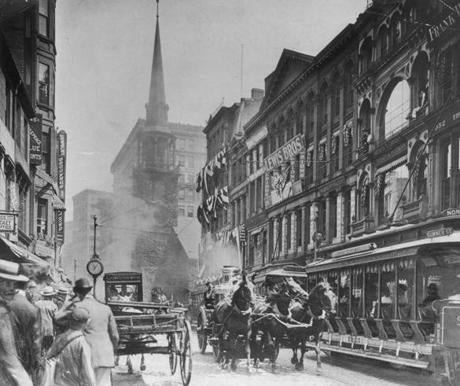 October 10 1910 / fromthearchive / Globe Archive photo / What appears to be a horse-drawn fire engine headed one way down Washington Street as the North Station / East Cambridge trolley headed another. The Old South Meeting House can be seen in the background. / fromthearchive /