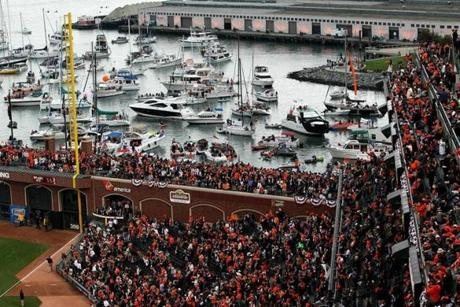 SAN FRANCISCO - OCTOBER 27: Boaters and fans congregate in McCovey Cove outside of AT&T Park during Game One of the 2010 MLB World Series between the Texas Rangers and the San Francisco Giants on October 27, 2010 in San Francisco, California. (Photo by Doug Pensinger/Getty Images) NYTCREDIT: Doug Pensinger/Getty Images 25california
