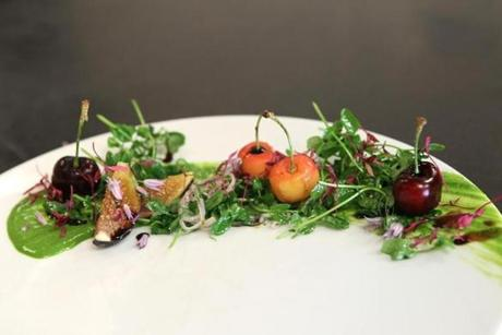 Deuxave chef de cuisine Adrienne Mosier's preparation of roasted black mission figs with balsamic and pea shoots.