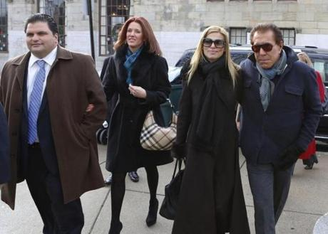 DeMaria and his wife, Stacey (left), arrived at City Hall in Everett with casino mogul Steve Wynn and his wife, Andrea Hissom, in 2012. The names of DeMaria's friends had disappeared on paperwork by the time Wynn arrived.