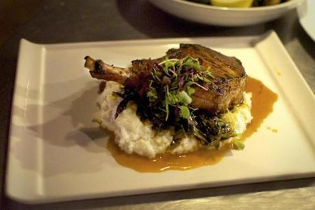 Pork chops with black pepper-thyme grits and collards greens.