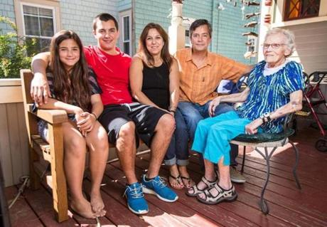 06/20/2014 SOMERVILLE, MA L-R Kira Guardia (cq) 11, RJ Guardia (cq) 17, Jill Guardia (cq) and Rick Guardia (cq) with Jill's mother Irene Silverman (cq) 85, at their home in Somerville. Irene moved in with the family in 1997 when RJ was born. (Aram Boghosian for Boston.com)