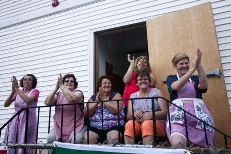 Spectators cheered from their porches as the Boston Portuguese Festival Parade passed by in Somerville.
