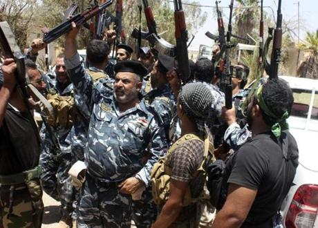 Iraqi security forces and volunteers rallied on the outskirts of a  town in Diyala province on Sunday.