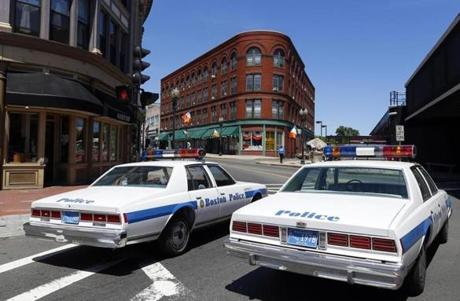 "Vintage police cruisers were seen in Lynn as two streets were taken over to film a St. Patrick's Day parade scene for the movie ""Black Mass"" on June 23."