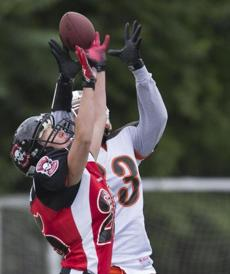 Boston Militia's Jen Olivieri breaks up a pass intended for Cleveland Fusion Cat Cain during first half action of the second round of the 2014 WFA Playoffs at Dilboy Stadium June 21, 2014.