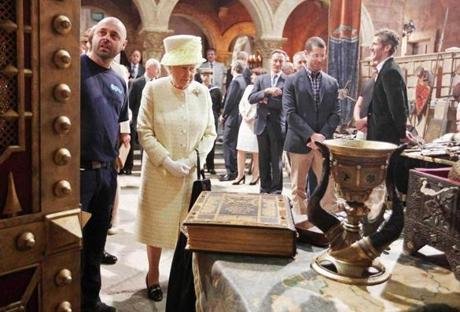 "Queen Elizabeth II met some of the costume and prop designers in the old Harland and Wolf paint room during her visit to the set of ""Game of Thrones"" in Belfast's Titanic Quarter on June 24."