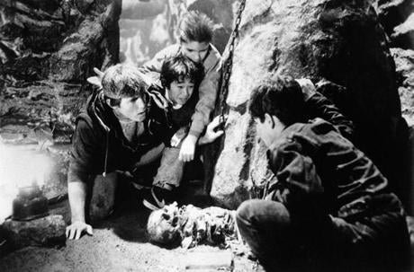"In this photo provided by Warner Bros., young cast members are shown in a scene from the movie ""The Goonies,"" 1985. From left: Josh Brolin, Ke Huy Quan, Corey Feldman, and unidentfied. (AP Photo/Warner Bros.)"